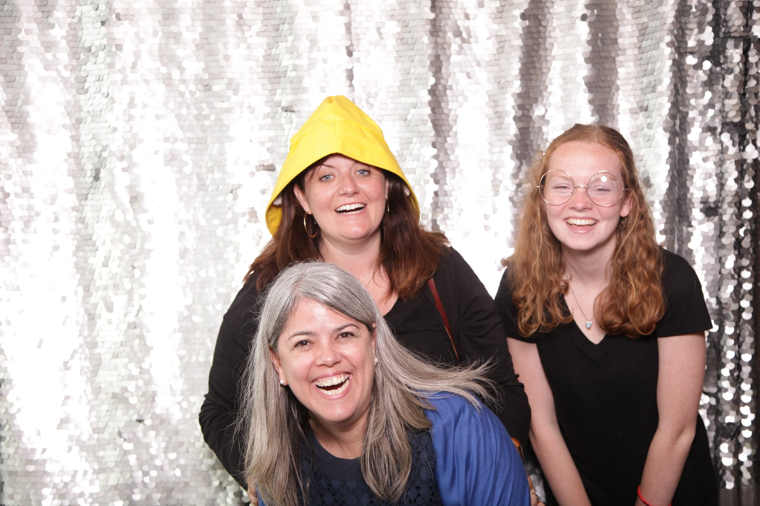 3 people in a Maine photo booth at a wedding